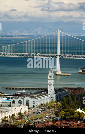 View from Coit Tower over San Francisco Bay with the Oakland Bay Bridge and the Ferry Building, San Francisco, California, - Stock Photo
