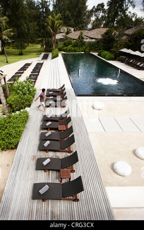 Aerial view of lawn chairs on deck - Stock Photo