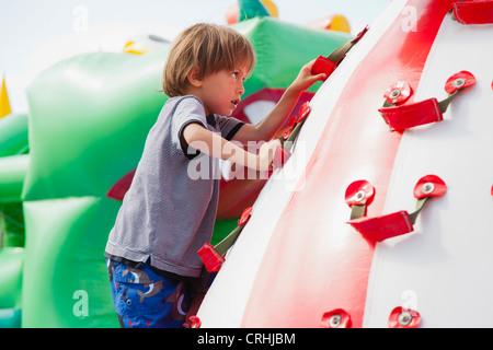 Boy climbing on playground - Stock Photo