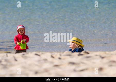 Children playing on sandy beach - Stock Photo