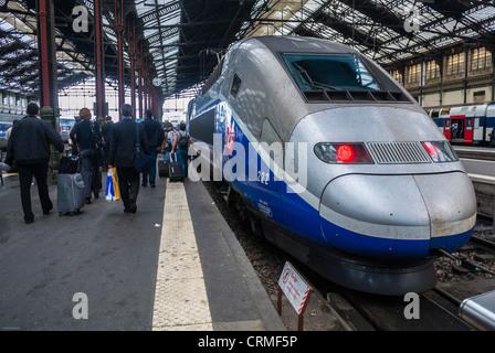 Paris, France, Tourists Traveling on Quay inside Train Station, T.G.V. Bullet Train, in 'Gare de Lyon', - Stock Photo