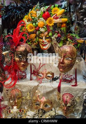 A shop window display of Venetian Carnival masks. - Stock Photo