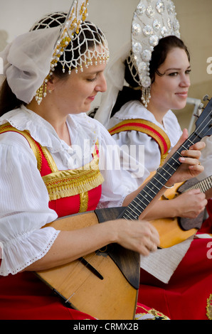 Ukraine, Yalta, Livadia Palace. Ukrainian folkloric show. Women in traditional costumes playing Russian balalaikas - Stock Photo