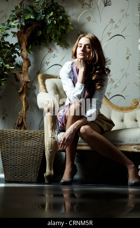Portrait of a gorgeous young woman in a luxury suite - Stock Photo