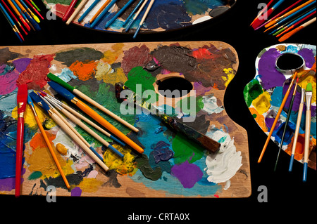 Artist palette with multicolored brushes for painting - Stock Photo