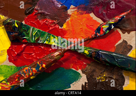 Artist palette with paint knife for mixing paints - Stock Photo