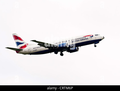 British Airways Boeing 737-436 Airliner G-DOCL on Approach to London Gatwick Airport West Sussex England United - Stock Photo