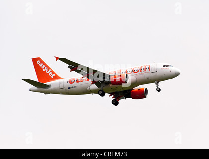 EasyJet Airbus A319-111 Airliner G-EJAR on Approach to London Gatwick Airport West Sussex England United Kingdom - Stock Photo