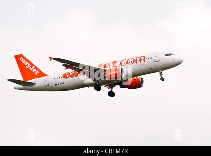 EasyJet Airbus A320-214 Airliner G-EZUF on Approach to London Gatwick Airport West Sussex England United Kingdom - Stock Photo