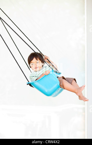 boy swinging - Stock Photo