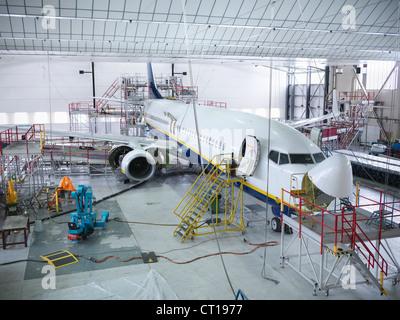 Airplane built in hangar - Stock Photo