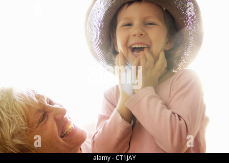 Woman with granddaughter outdoors - Stock Photo
