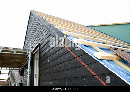 Siding of building under construction - Stock Photo