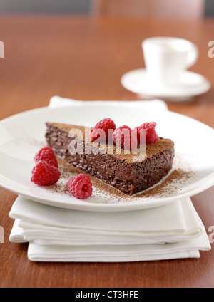 Plate of chocolate cake with berries - Stock Photo