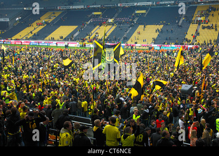 fans of bvb borussia dortmund spectators mercedes benz arena stock photo royalty free image. Black Bedroom Furniture Sets. Home Design Ideas