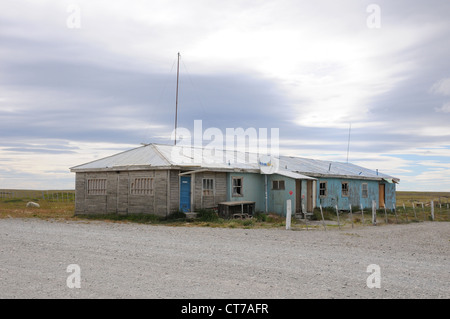 Dilapidated hut, tin and wood office building, remote landscape, Patagonia, Chile - Stock Photo