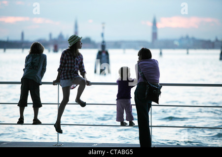 Family at the pier in Lido di Venezia, View towards Venice, Veneto, Italy - Stock Photo