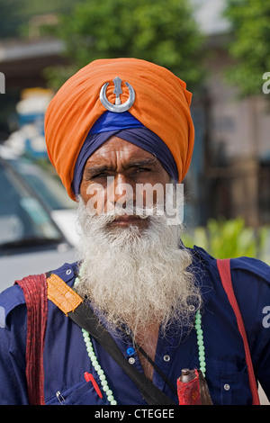 Portrait of Sika Hindu religious man in Bangla Shib Gurudwara Sika Great Temple in New Delhi India - Stock Photo