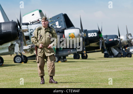 Fancy dress US Soldier in front of aircraft on the flightline at the Flying Legends Airshow 2011, Imperial War Museum, - Stock Photo