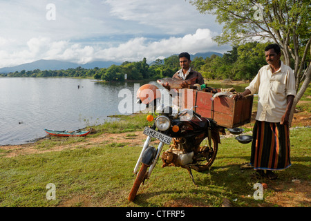 Men selling fish at Lake Kandalama, Sri Lanka - Stock Photo