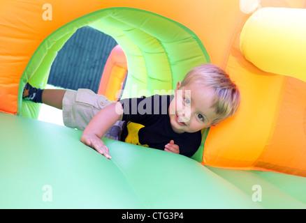 Child on bouncy castle - Stock Photo
