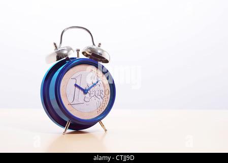 EU Europe euro coin on an alarm clock - Stock Photo