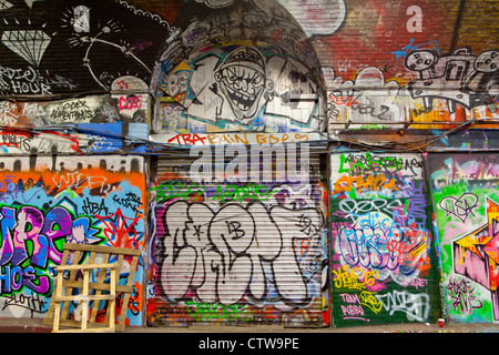 graphiti on a wall and security shutter - Stockfoto