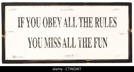 Handmade wooden sign with a distressed paint effect finish with text ' If you obey all the rules, you miss all the - Stock Photo
