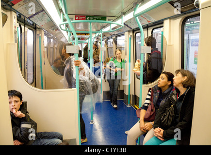 Passengers inside a carriage of a train, London Docklands Light Railway (DLR); London UK - Stock Photo