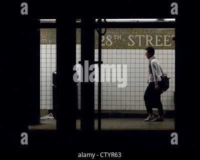 A commuter at 28th Street subway station. New York, New York, USA. 26-July-2012. - Stock Photo