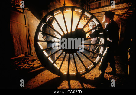 A welder works on the 6ft 8 inch Driving wheels of LNER Class A1 Steam Locomotive 60163 Tornado at a foundry in - Stock Photo