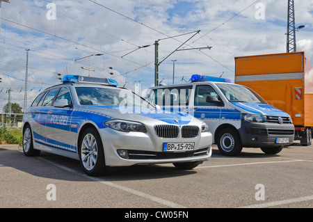 bmw and vw volkswagen police patrol cars of the german federal police stock photo royalty free. Black Bedroom Furniture Sets. Home Design Ideas