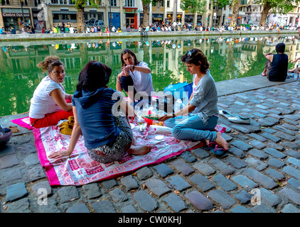 Paris, France, Young Women Picnicking in the 'Canal Saint Martin' Area, - Stock Photo
