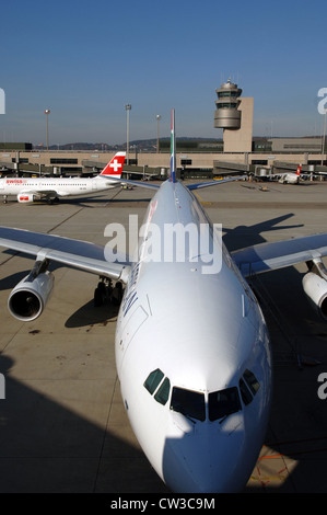 Passenger aircraft at the airport of Zurich (Switzerland) - Stock Photo
