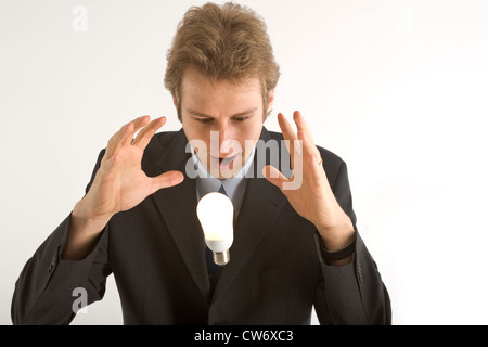 business man with light bulb - Stock Photo