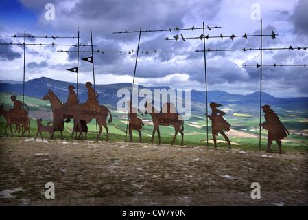 Alto del Perdon and the wrought iron sculpture of medieval pilgrims heading to Santiago de Compostela near Uterga - Stock Photo