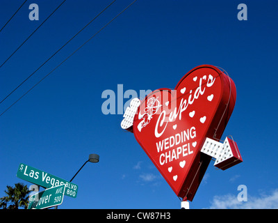 Cupid's Wedding Chapel Red Heart Sign Neon Arrow Las Vegas Blvd & Hoover Ave Street Signs Las Vegas Nevada USA - Stock Photo