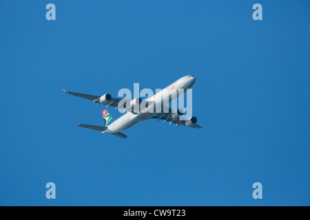 South African Airways Airbus A340-642 airplane ZS-SNG (cn 557) with a special 'Beijing 2012' dragon sticker - Stock Photo