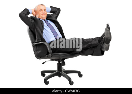 Mature businessman resting in armchair with legs up isolated on white background - Stock Photo