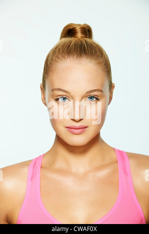 Portrait of a beautiful young woman with hair up - Stock Photo
