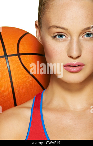 Young woman with basketball - Stock Photo