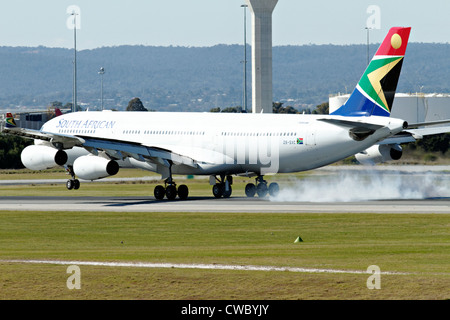 South African Airways Airbus A340-300 landing at Perth Airport - Stock Photo
