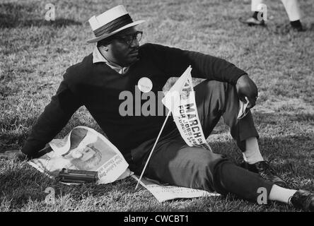 1963 March on Washington. A male marcher relaxing on the grass of the Capitol Mall. Aug. 28, 1963. - Stock Photo