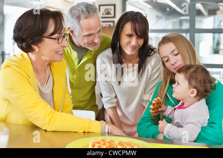 Happy multi-generation family at home - Stock Photo