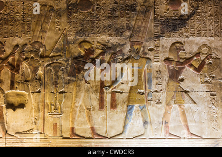 Colored relief depicting Amun at the temple of Seti I in Abydos, Egypt - Stock Photo
