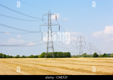 Electricity pylons in countryside - Stock Photo