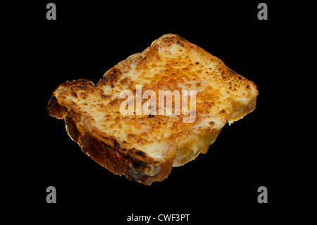 TOAST WITH VARIOUS TOPPINGS SHOT ON BLACK BACKGROUND BEANS,JAM,CHEESE,EGG,FOOD,QUICK FOOD ,SIMPLE FOOD ,FAST FOOD, - Stock Photo
