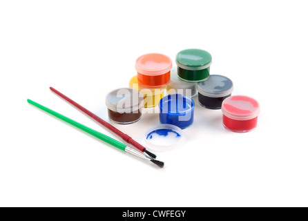 boxes of paints and brushes on a white background - Stock Photo