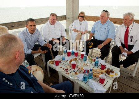 President Barack Obama participates in a roundtable discussion and lunch with local residents at Combs Pier in Gulfport, - Stock Photo