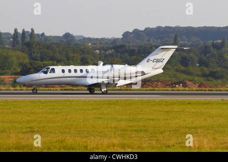 Cessna 525A Citation Jet CJ2 taking off from runway - Stock Photo